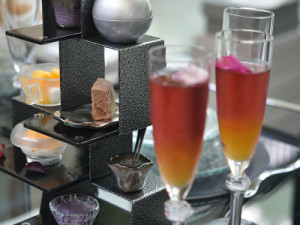 Champagne flutes on metal pedestal with custom color glass crystal