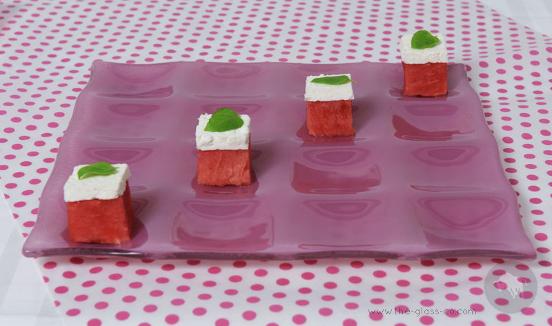 pink square plate with sixteen inlets for fruit presentation for watermelon day